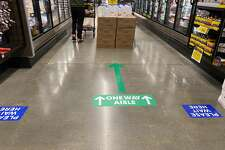 The Kroger Family, which runs stores such as QFC and Fred Meyer, implemented limits to lower the number of customers in the store to 50% of the building's code capacity starting April 7. While the standard capacity for a grocery store is one person per 60 square feet, the new measures will reduce that number to one person per 120 square feet.