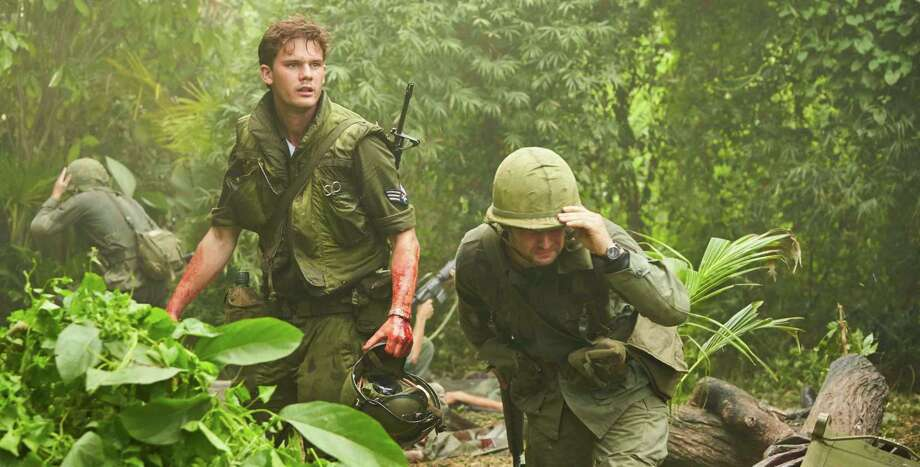 """Jeremy Irvine (left) stars in """"The Last Full Measure,"""" which tells the story of a Vietnam War medic who won the Medal of Honor. Photo: Associated Press / Roadside Attractions"""