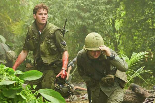 """Jeremy Irvine (left) stars in """"The Last Full Measure,"""" which tells the story of a Vietnam War medic who won the Medal of Honor."""