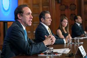 New York State Health Commissioner Howard Zucker, left, joins Gov. Andrew Cuomo, center, during a coronavirus update press conference on Tuesday, April 7, 2020, in the Red Room at the Capitol in Albany, N.Y.  (Office of the Governor)