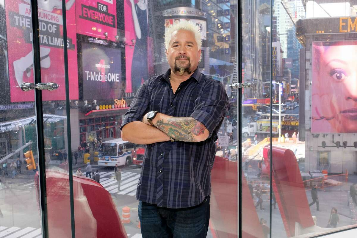 """Guy Fieri visits """"Extra"""" at their New York studios at H&M in Times Square on Oct. 11, 2016 in New York City. The celebrity chef recently launched a relief fund for furloughed restaurant employees, but a flood of applications crashed the site."""