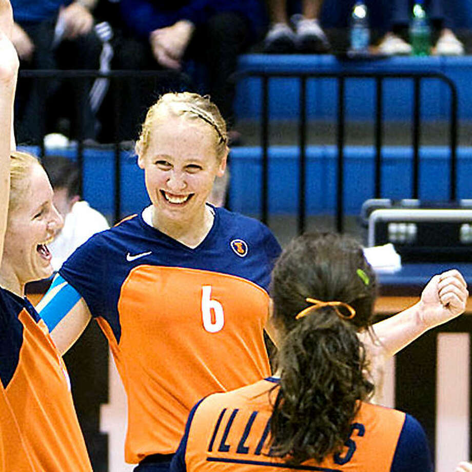 Michelle Bartsch-Hackley, center, celebrates with teammates during her days with the Illini volleyball team. Bartsch-Hackley, a Collinsville native, has been named to the 2020 University of Illinois Athletics Hall of Fame. Photo: File Photo