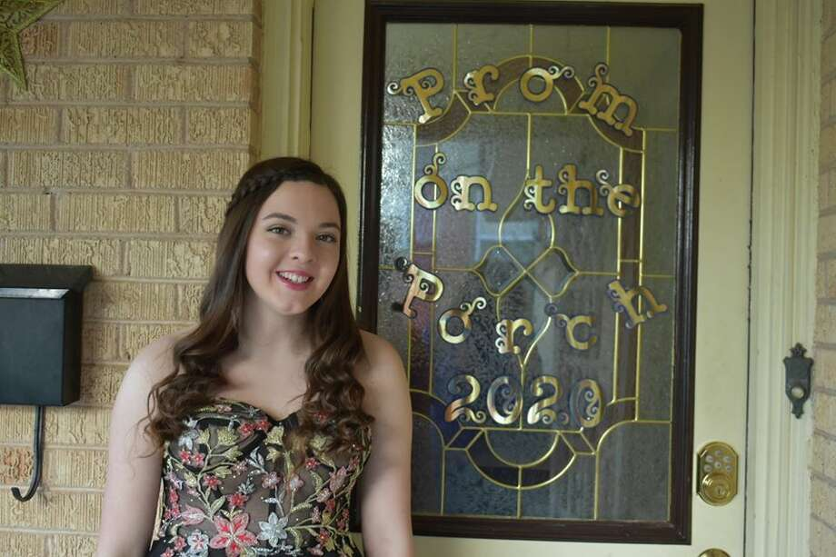 Grayson Chapman dressed up in her prom dress she originally planned to wear at her high school prom in Nolan County. The prom was canceled due to COVID-19 pandemic. Photo: Jaci Chapman