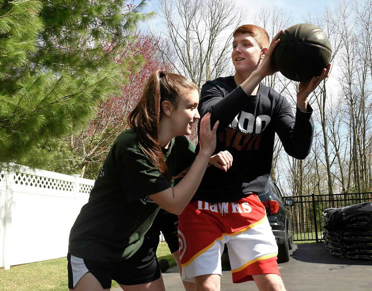 Atlanta Hawks basketball player Kevin Huerter plays basketball with his sisters Meghan, left, and Jillian, not in photo at their home on Tuesday, April 7, 2020 in Clifton Park, N.Y. The girls play basketball for Shenendehowa where Kevin also played. (Lori Van Buren/Times Union)