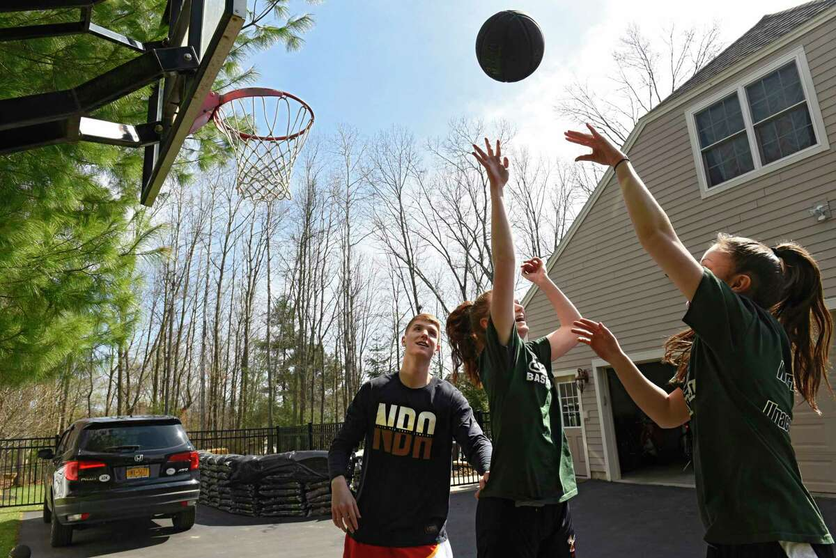 Atlanta Hawks basketball player Kevin Huerter plays basketball with his sisters Meghan, right, and Jillian at their home on Tuesday, April 7, 2020 in Clifton Park, N.Y. The girls play basketball for Shenendehowa where Kevin also played. (Lori Van Buren/Times Union)