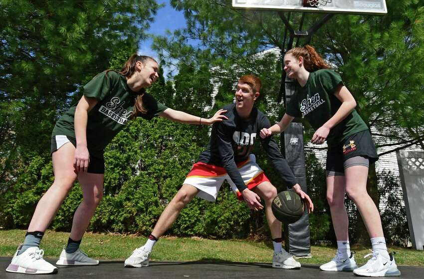 Atlanta Hawks basketball player Kevin Huerter plays basketball with his sisters Meghan, left, and Jillian at their home on Tuesday, April 7, 2020 in Clifton Park, N.Y. The girls play basketball for Shenendehowa where Kevin also played. (Lori Van Buren/Times Union)