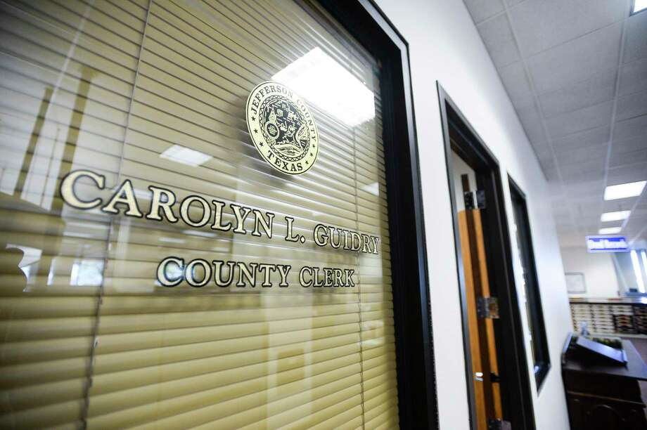 A window in the County Clerks office with Carolyn Guidry's name on it. Photo taken on Tuesday, 04/09/19. Ryan Welch/The Enterprise Photo: Ryan Welch / Ryan Welch/The Enterprise / ©Ryan Welch