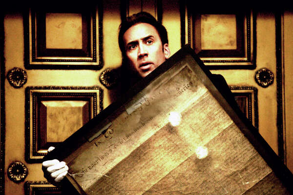 "Ben Gates (Nicolas Cage) steals the Declaration of Independence in order to uncover the final clues leading to the treasure his family has chased for generations in ""National Treasure."" (AP Photo/Buena Vista Pictures/Robert Zuckerman)"