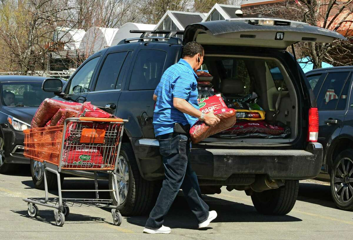A customer loads mulch in his car outside The Home Depot on Tuesday, April 7, 2020 in Guilderland, N.Y. (Lori Van Buren/Times Union)