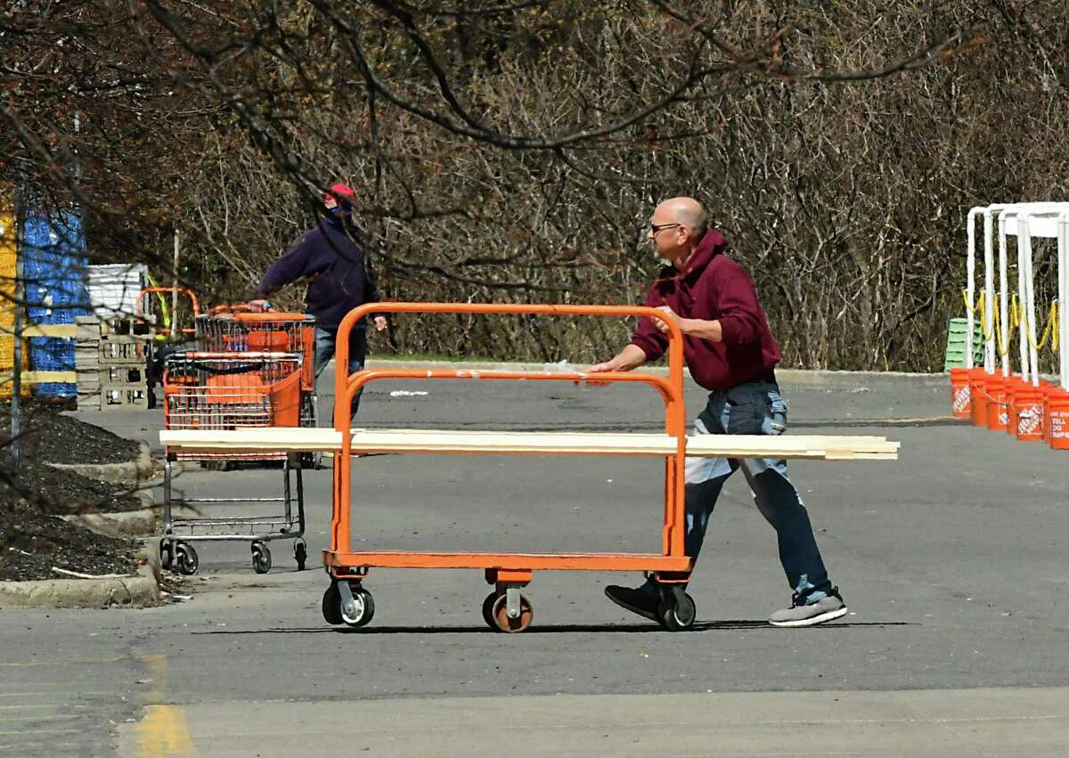A customer wheels lumber to his car at The Home Depot on Tuesday, April 7, 2020 in Guilderland, N.Y. (Lori Van Buren/Times Union)