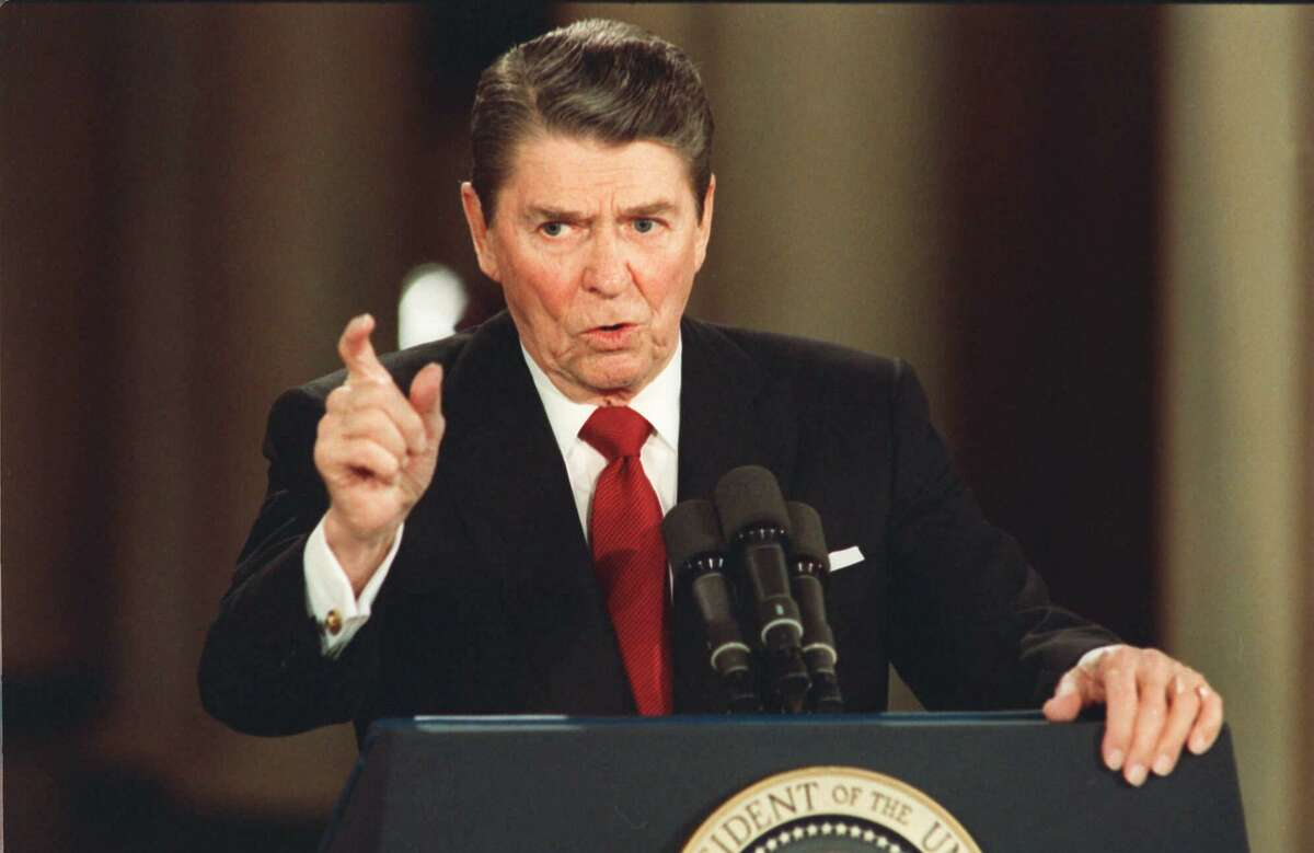 FILE--President Ronald Reagan gestures in this March 20,1987, file photo during a news conference at the White House. Reagan said he never deliberatly lied to the public, although he admitted to a misstatment about Israeli involvement in the Iran-Contra affair. (AP Photo/Dennis Cook, File)