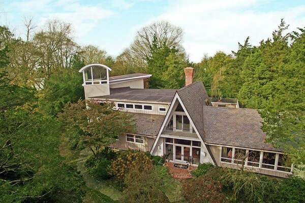 The house sits on a 1.61-acre level and professionally landscaped rear lot, giving it much privacy.