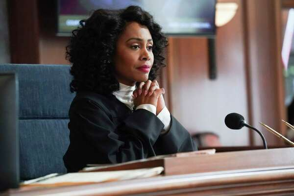 "This image released by CBS shows Simone Missick in a scene from ""All Rise."" The CBS series will virtually produce an episode that reflects the worlda€™s current state of the COVID-19 pandemic, social distancing and its impact on the criminal justice system. (Monty Brinton/CBS via AP)"