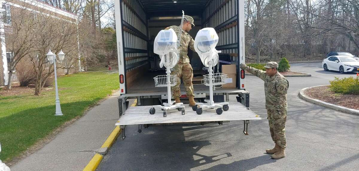 Members of the National Guard load ventilators from Pathways Nursing and Rehabilitation Center in Niskayuna on April 7, 2020.
