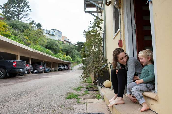 Izabel Arnold, 26, with her three-year-old son Arlo outside her home on Saturday, March 28, 2020, in San Francisco, Calif.