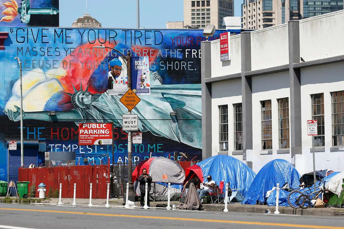 Tents are pitched near a homeless shelter at Fifth and Bryant streets during the coronavirus pandemic in San Francisco, Calif. on Tuesday, April 7, 2020.