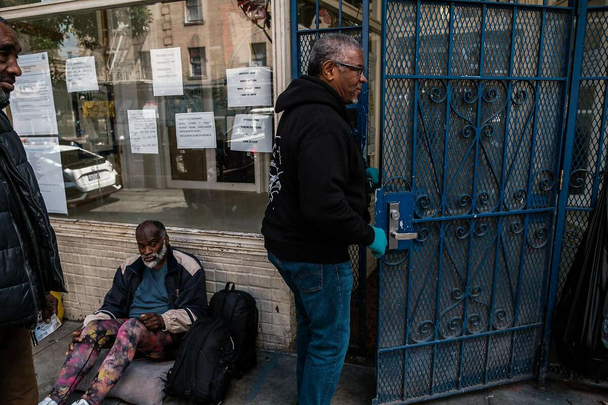 Joe Wilson, the executive director of Hospitality House, a men's homeless shelter in the Tenderloin enters the shelter in San Francisco, Calif. on Tuesday April 7, 2020.