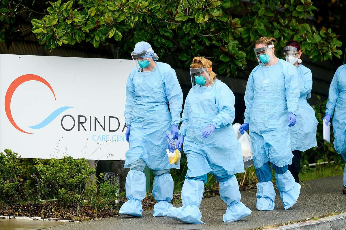 Nurses from John Muir Medical Center prepare to enter Orinda Care Center, where nearly 50 residents and staff members have tested positive for coronavirus, on Monday, April 6, 2020, in Orinda, Calif.
