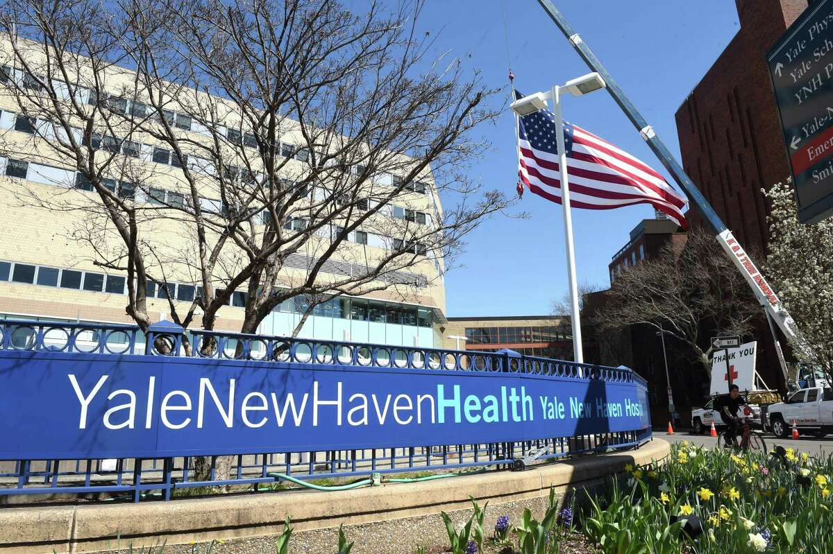 Kyle DeLucia, founder and owner of K&J Tree Service, put up a 50 foot United States flag and a large thank you across from the hospital on York Street to show his appreciation for the work of the staff of Yale New Haven Hospital on April 6, 2020.