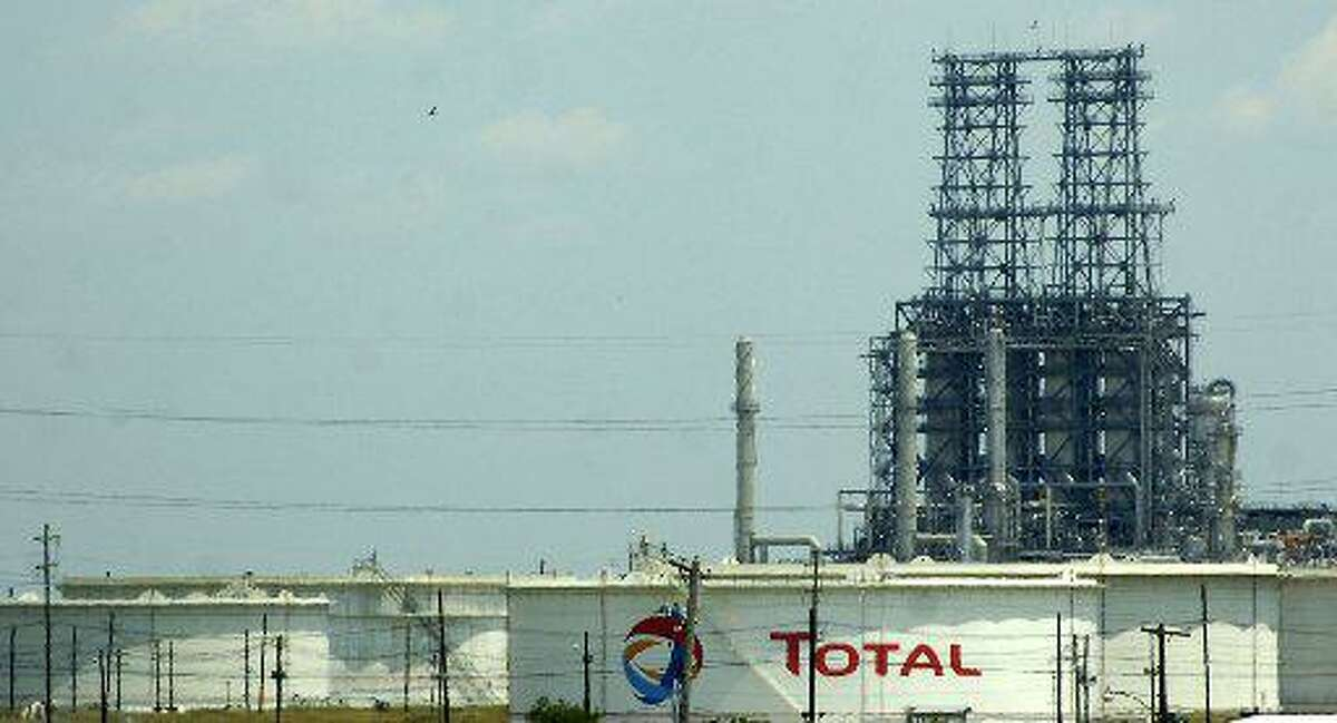 Total investors want the oil major to match commitments made by its rivals.