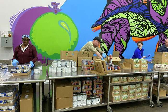 Local food banks are working in overdrive to help feed Houston area residents as many have suddenly lost their jobs. Food banks are also opportunities for volunteer work, as these people sort and pack food at the Houston Food Bank.