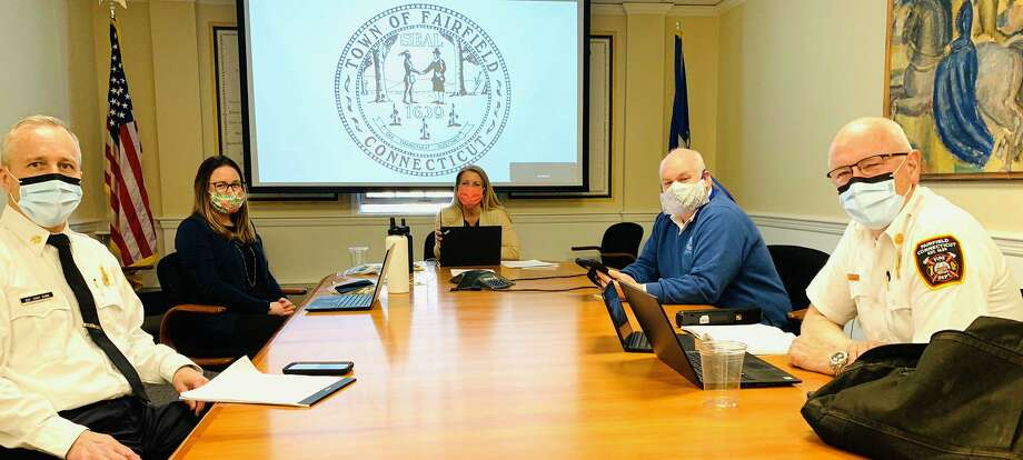 (Left to right): Deputy Fire Chief Kyran Dunn, Chief of Staff Jackie Bertolone, First Selectwoman Brenda Kupchick, Health Department Director Sands Cleary and Fire Chief Denis McCarthy wearing facemasks during a meeting of the Emergency Management Team. Photo: / First Selectwoman Brenda Kupchick