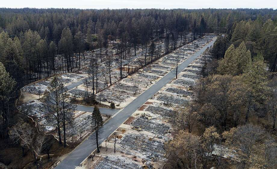 FILE - This Dec. 3, 2018, file photo shows homes leveled by the Camp Fire line at the Ridgewood Mobile Home Park retirement community in Paradise, Calif. Lawyers who negotiated a deal between wildfire victims and Pacific Gas & Electric say questions about the beleaguered company's ability to pay $13.5 billion to the victims could unravel the deal, upending the company's efforts to get out of bankruptcy by June 30. Photo: Noah Berger / Associated Press 2018