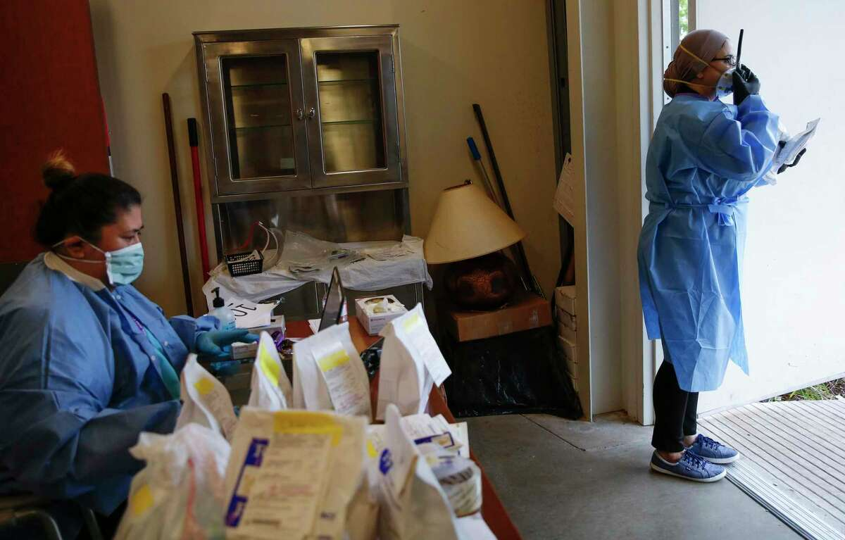 Pharmaceutical technician Norma Ollivares, left, works with Dr. Adlia Ebeid to distribute prescriptions at the San José Clinic in the Midtown neighborhood in Houston on Thursday, April 2, 2020.