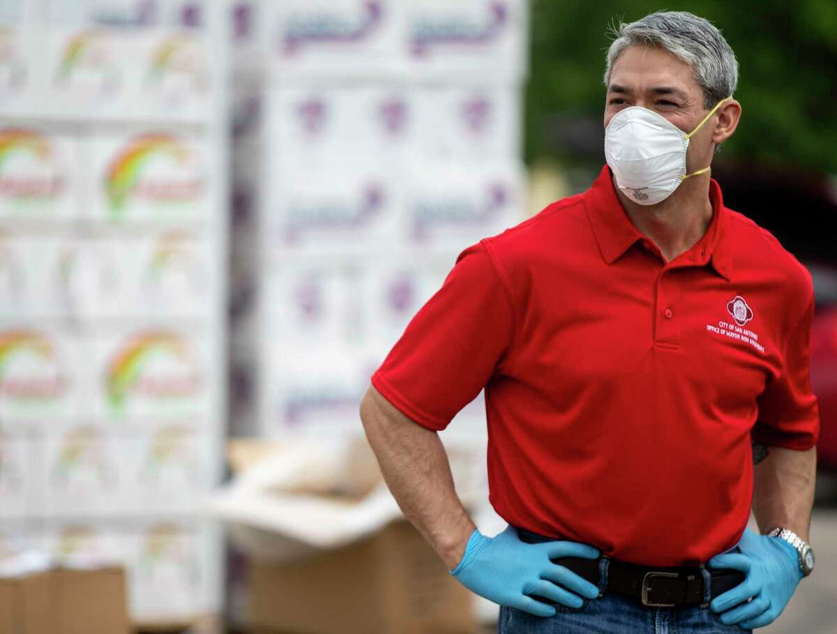San Antonio Mayor Ron Nirenberg waits for a car to pull up to his station during a San Antonio Food Bank drive-through food distribution on Tuesday, April 7, 2020, in the Toyota Field parking lot in San Antonio, Texas.