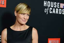 "FILE - In this Feb. 13, 2014 file photo, Robin Wright arrives at a special screening for season 2 of ""House of Cards"", in Los Angeles. The trailer for the next season of a€œHouse of Cardsa€ is missing Kevin Spacey and declares: a€œThe reign of the middle-aged white man is over.a€ The trailer released Thursday, Sept. 27, 2018 depicts Wrighta€™s Claire Underwood taking over as president after her husbanda€™s death in the Netflix series. (Photo by Jordan Strauss/Invision/AP, File )"
