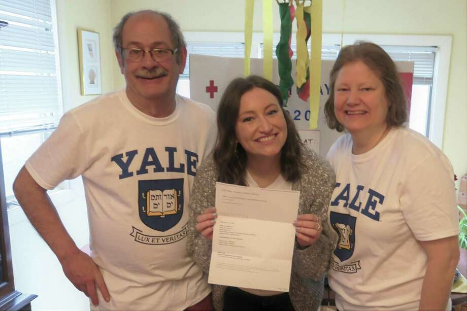 Jennifer Lawson of New Milford was informed March 20 that she will be assuming her residency at Yale-New Haven Hospital. It is anticipated that Jennifer will be joining the fight against COVID-19. Jennifer is shown above with her mother and father, David and Lisa Lawson. Photo: Courtesy Of The Lawsons