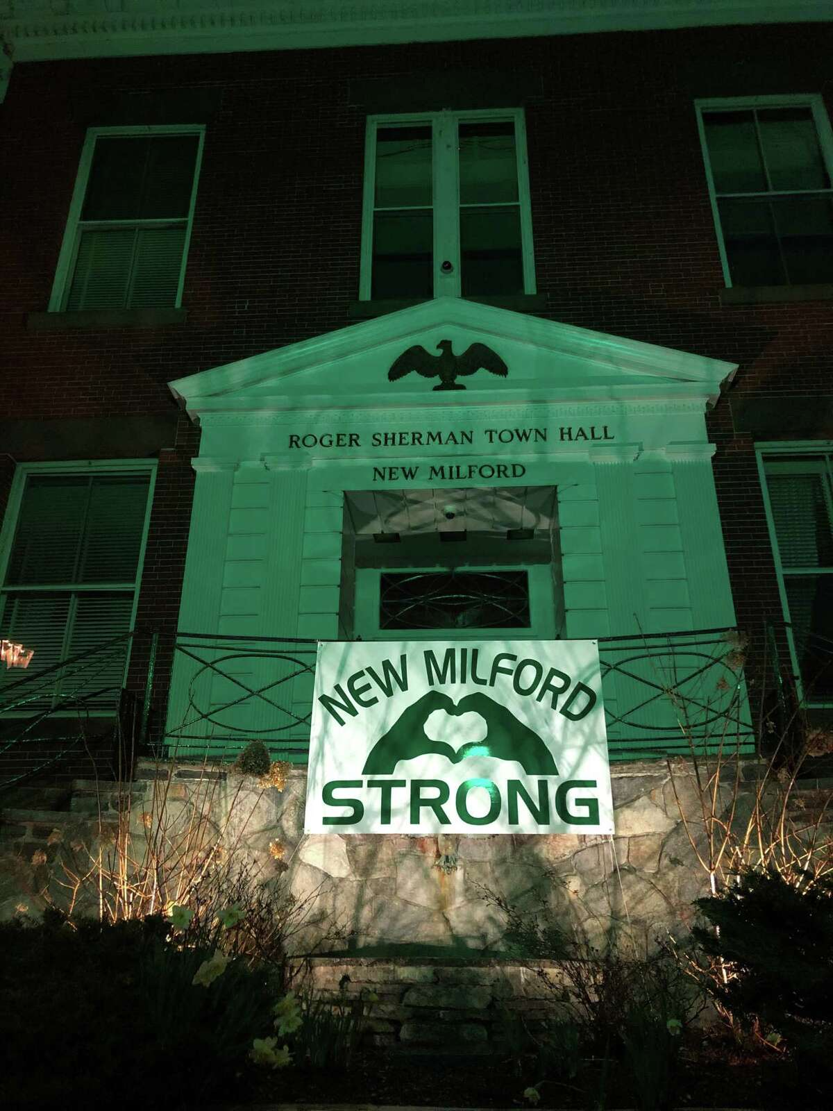 A message of hope and unity proudly hangs in front of the Roger Sherman Town Hall in New Milford.