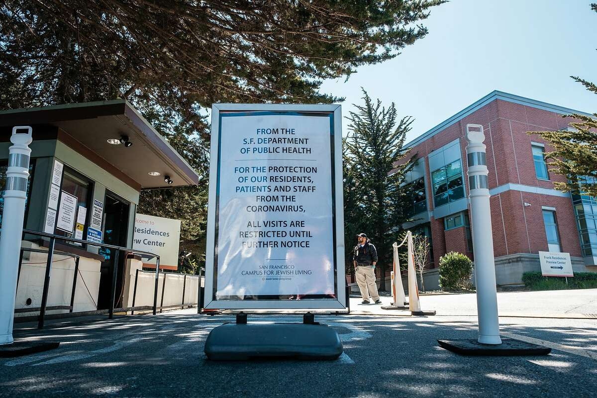 A Security guard stands out front of the San Francisco Campus for Jewish Living in San Francisco, Calif. on Thursday April 2, 2020.