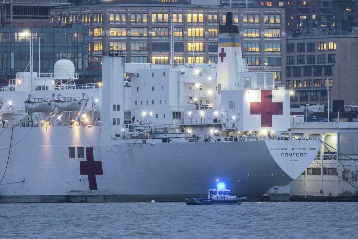 WEST NEW YORK, NJ - APRIL 03: The USNS Comfort navy hospital ship is docked at Pier 90 on April 3, 2020 in New York City as seen from West New York, New Jersey. According to reports, the military hospital ship's 1,000 beds, expected to help overcrowded hospitals dealing with the city's COVID-19 outbreak, remain mostly unused. (Photo by Kena Betancur/Getty Images)