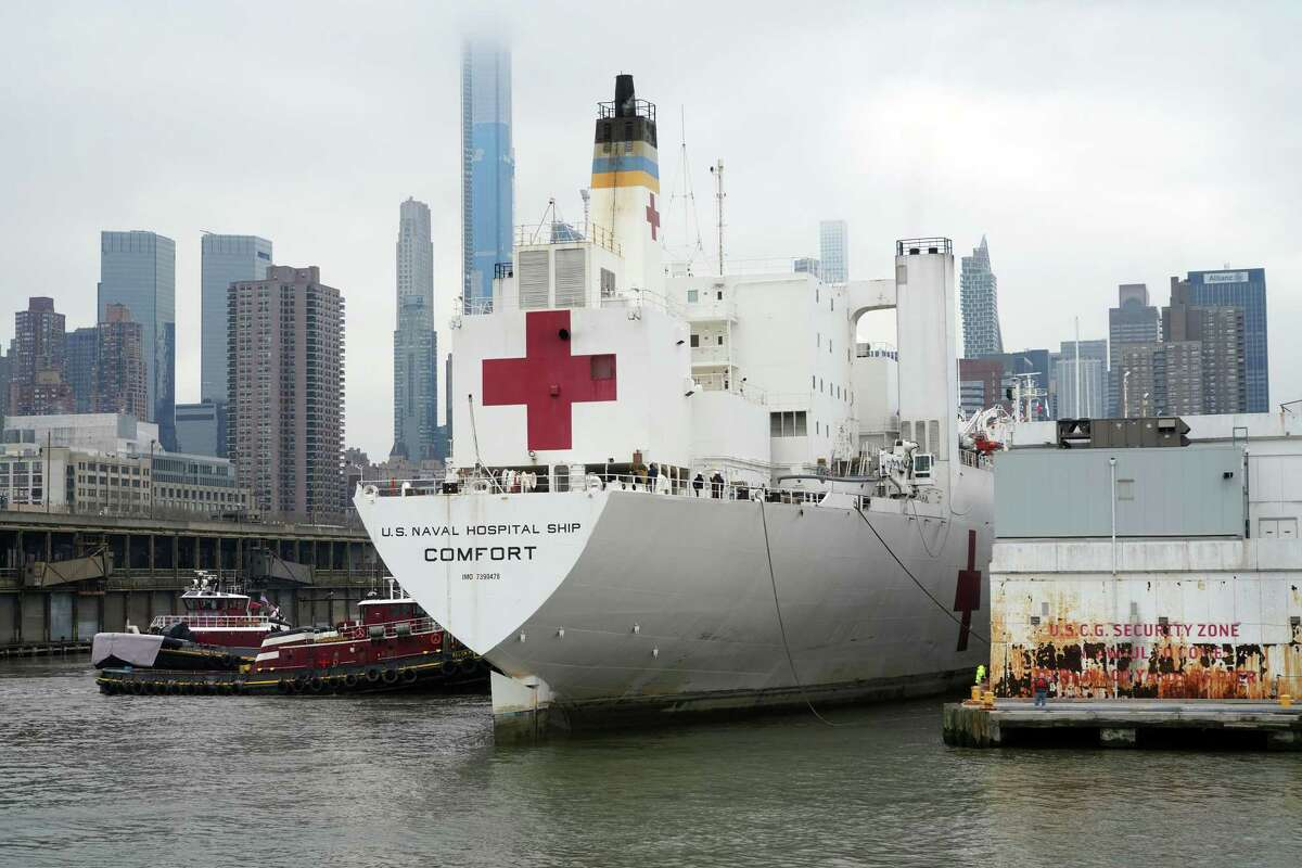 The USNS Comfort, a Navy hospital ship, in New York, March 30, 2020. As of Thursday, though, the huge white vessel, which officials had promised would bring succor to a city on the brink, sat mostly empty, its 1,000 beds unused, its 1,200-member crew mostly idle. (Chang W. Lee/The New York Times)
