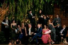 """This image released by ABC shows the cast of the ABC sitcom """"Modern Family,"""" from left, Reid Ewing, Ariel Winter, Ty Burrell Julie Bowen, Eric Stonestreet, Nolan Gould, standing left center, Jesse Tyler Ferguson, Aubrey Anderson-Emmons, standing center right, Jeremy Maguire, Sarah Hyland, seated holding baby, SofA-a Vergara, Rico Rodriguez and Ed O'Neill. The comedy will air its series finale after 11 seasons on April 8, the network announced on Wednesday. (Jill Greenberg/ABC via AP)"""