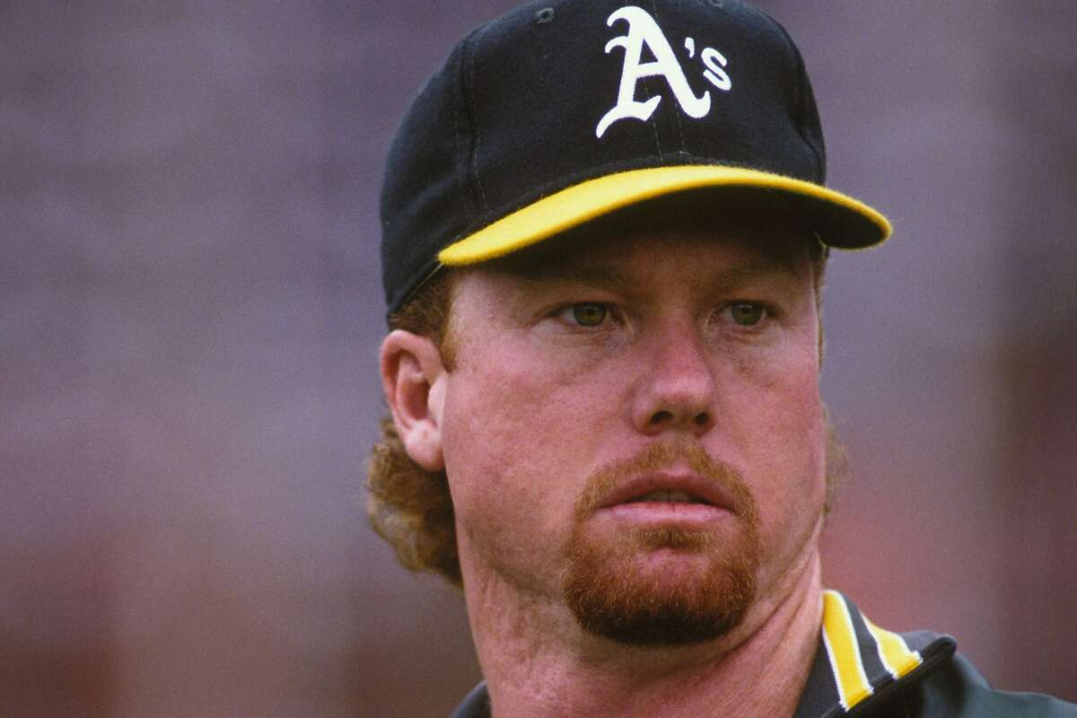 BALTIMORE, MD - JULY 18: Mark McGwire #25 of the Oakland Athletics looks on during a baseball game against the Baltimore Orioles on April 18, 1992 at Camden Yards in Baltimore, Maryland. ~~