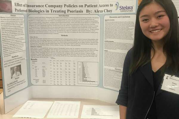 Sacred Heart Greenwich senior Alexa Choy is pictured here next to the poster she created detailing the results of her multi-year research project. Her paper on how the cost of psoriasis treatments impact how doctors decide to prescribe drugs to patients in the private setting was published in a peer-reviewed journal in March after a year of edits and revisions. She is the first SHG student to have a paper appear in print where she is the first author listed, meaning she did the bulk of the work collecting and analyzing the data, and writing and editing the final paper.
