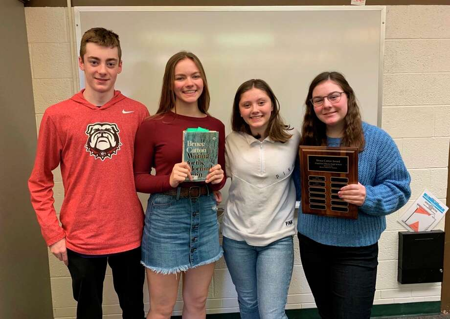 Rocco Anhalt, Presley Bartley, Kally Kowalewski andElli Tiesworth pose with the Bruce Catton Awards plaque and one of Catton's books. (Submitted photo)
