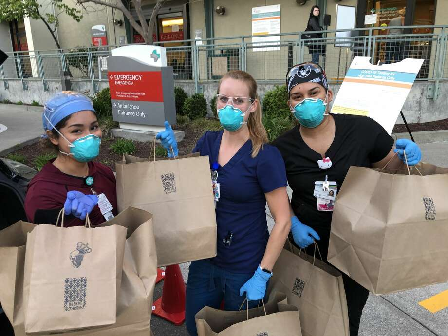 Hospital staff pose with bags of food from Oakland restaurant Duende, made possible by donors through the organization East Bay FeedER. Photo: Courtesy East Bay FeedER