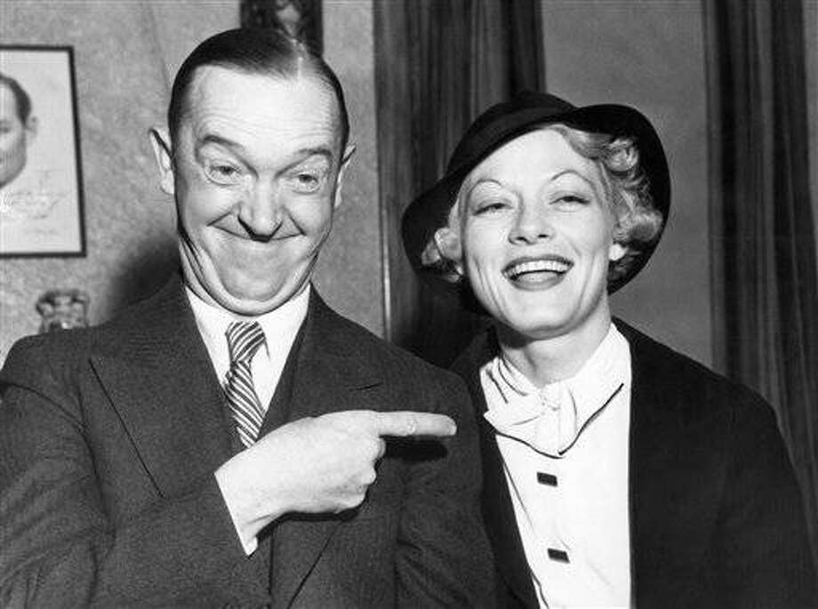 Stan Laurel, the smaller half of the movie comic team of Laurel and Hardy, and Mrs. Ruth Rogers, Los Angeles, California, widow, who announced they were married at Agua Caliente, Mexico on April 8, 1934, but would live apart in California until his divorce from Mrs. Lois Laurel becomes final next October 11. At that time, they will go through a second ceremony in California, Laurel said. They're shown on their return to Hollywood from the Mexican border resort. (AP Photo)