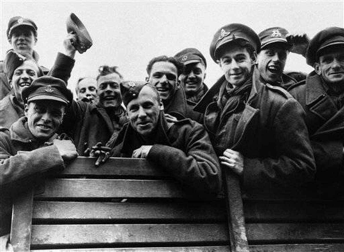 British prisoners freed by General Patton's fourth armoured division near Gotha, Germany on April 8, 1945. Some of them were taken prisoner at Dukirk, having spent five years in Nazi prison camps. They had been marched from the eastern front to Gotha. When the Germans learned of the American approach they started to march them back again to the east. These lads escaped and hid in the woods near Gotha until the fourth armoured division took the city. (AP Photo)