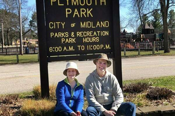 Bob and Sheryl Lane of Midland pose for a portrait Thursday, April 2, in Plymouth Park. The couple has a mission of exploring all of Midland's public parks. (Victoria Ritter/vritter@mdn.net)