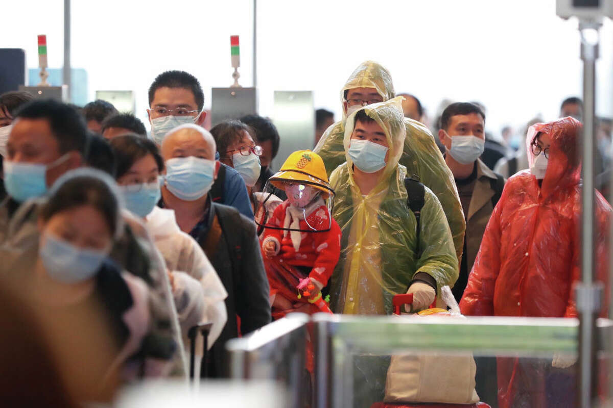 WUHAN, April 8, 2020 .Passengers of train G431 queue to enter the Wuhan Railway Station in Wuhan, capital of central China's Hubei Province, April 8, 2020. Train G431 from Wuhan to Nanning of south China's Guangxi Zhuang Autonomous Region, the first outbound train leaving Hubei Province from Wuhan since the outbound travel restrictions were lifted, reopened its service on Wednesday. Wuhan lifted outbound travel restrictions from Wednesday after almost 11 weeks of lockdown to stem the spread of COVID-19. (Photo by Shen Bohan/Xinhua via Getty) (Xinhua/Shen Bohan via Getty Images)