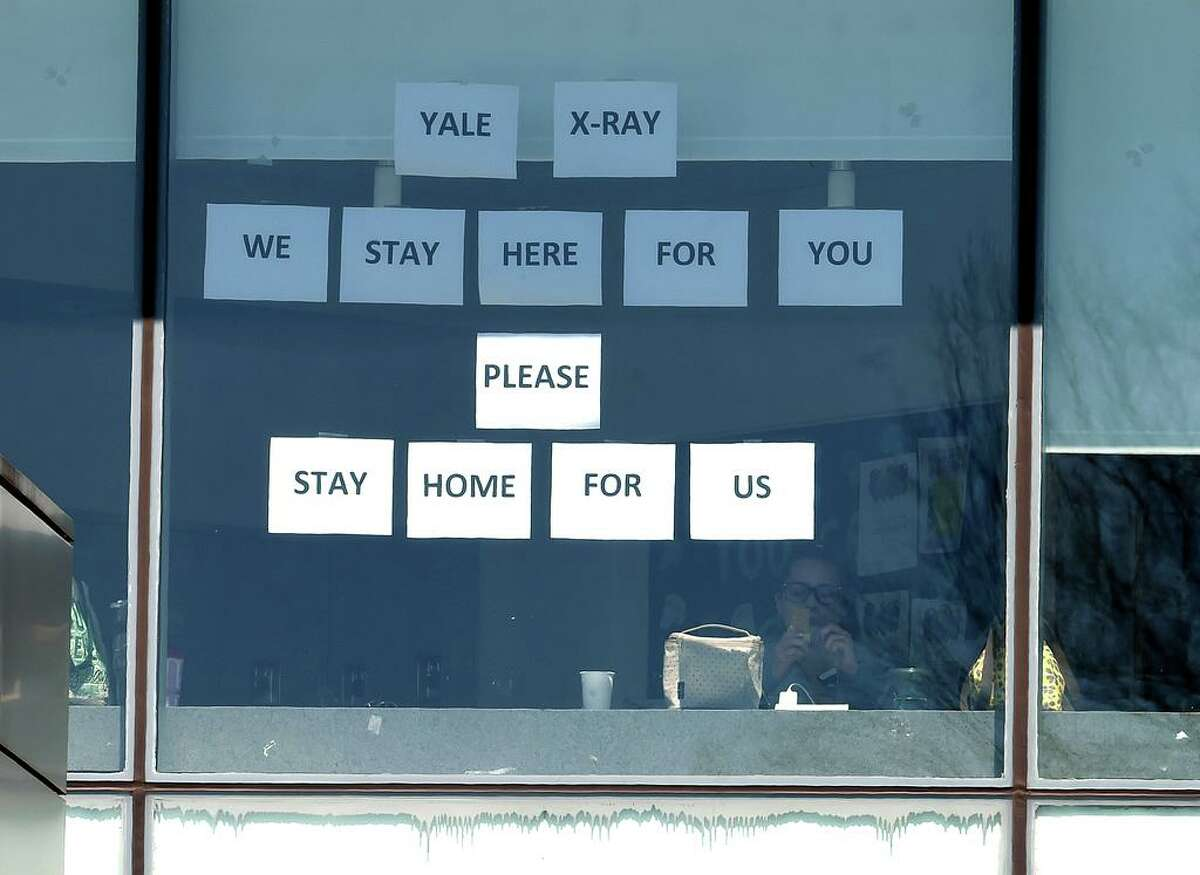 A sign put up by the X-ray Department at Yale New Haven Hospital reads We Stay Here For You Please Stay Home For Us on April 6, 2020.