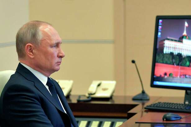 Russian President Vladimir Putin attend a meeting via video conference with heads of local governments at the Novo-Ogaryovo residence outside Moscow, Russia, Wednesday, April 8, 2020. The new coronavirus causes mild or moderate symptoms for most people, but for some, especially older adults and people with existing health problems, it can cause more severe illness or death. (Alexei Druzhinin, Sputnik, Kremlin Pool Photo via AP)