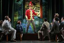 """Edward Watts as Harold Hill with the cast of Goodspeed Musicals' """"The Music Man"""" at Goodspeed."""