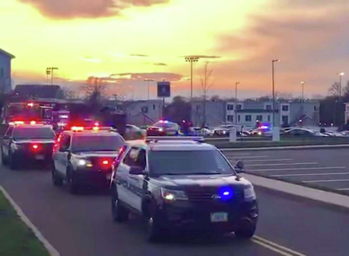 Police vehicles pull in to Stamford Hospital's campus Tuesday night as part of a procession to show thanks for hospital staff and the work they are doing to fight the coronavirus pandemic.