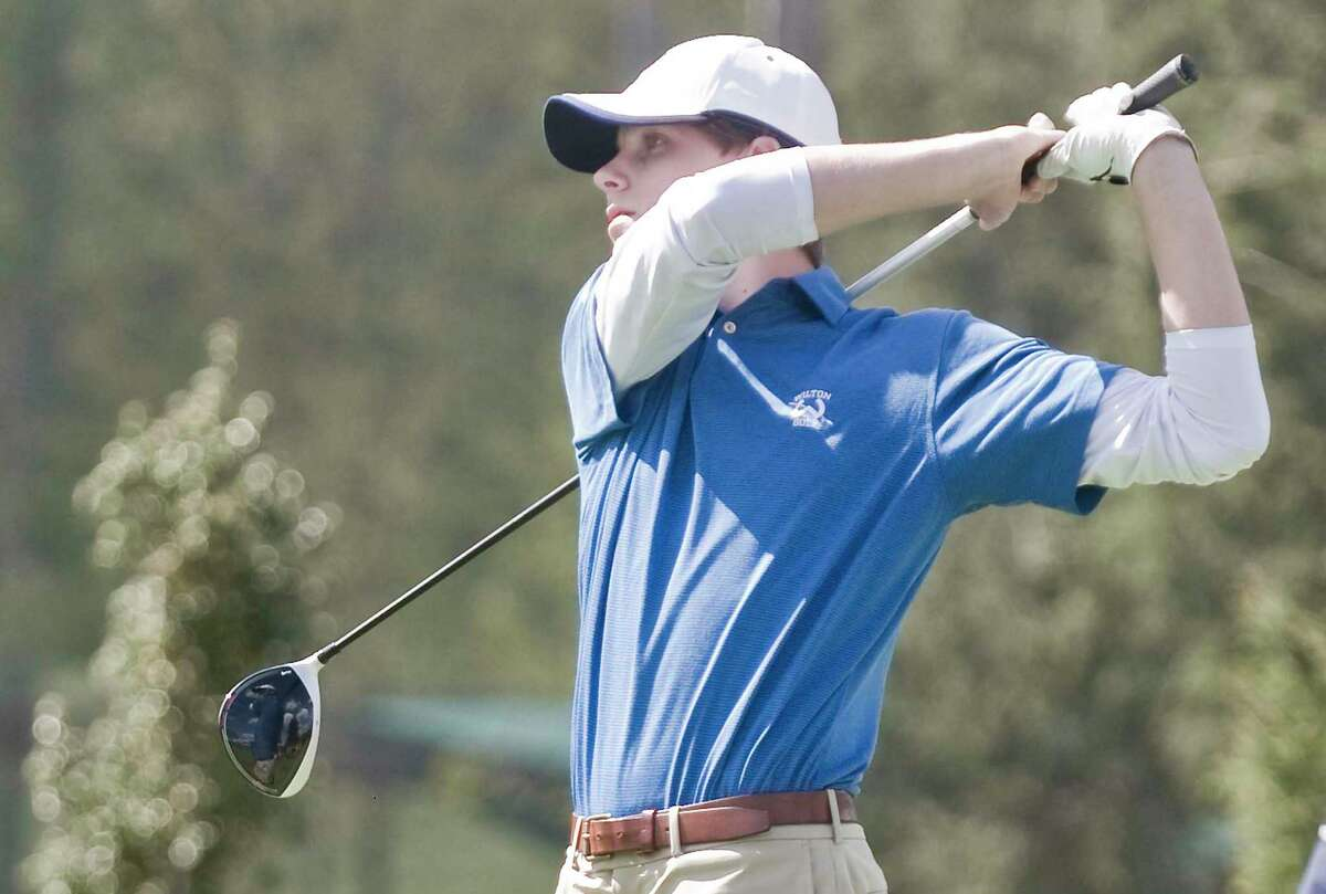 Andrew Smith follows the flight of his shot during a match last year.