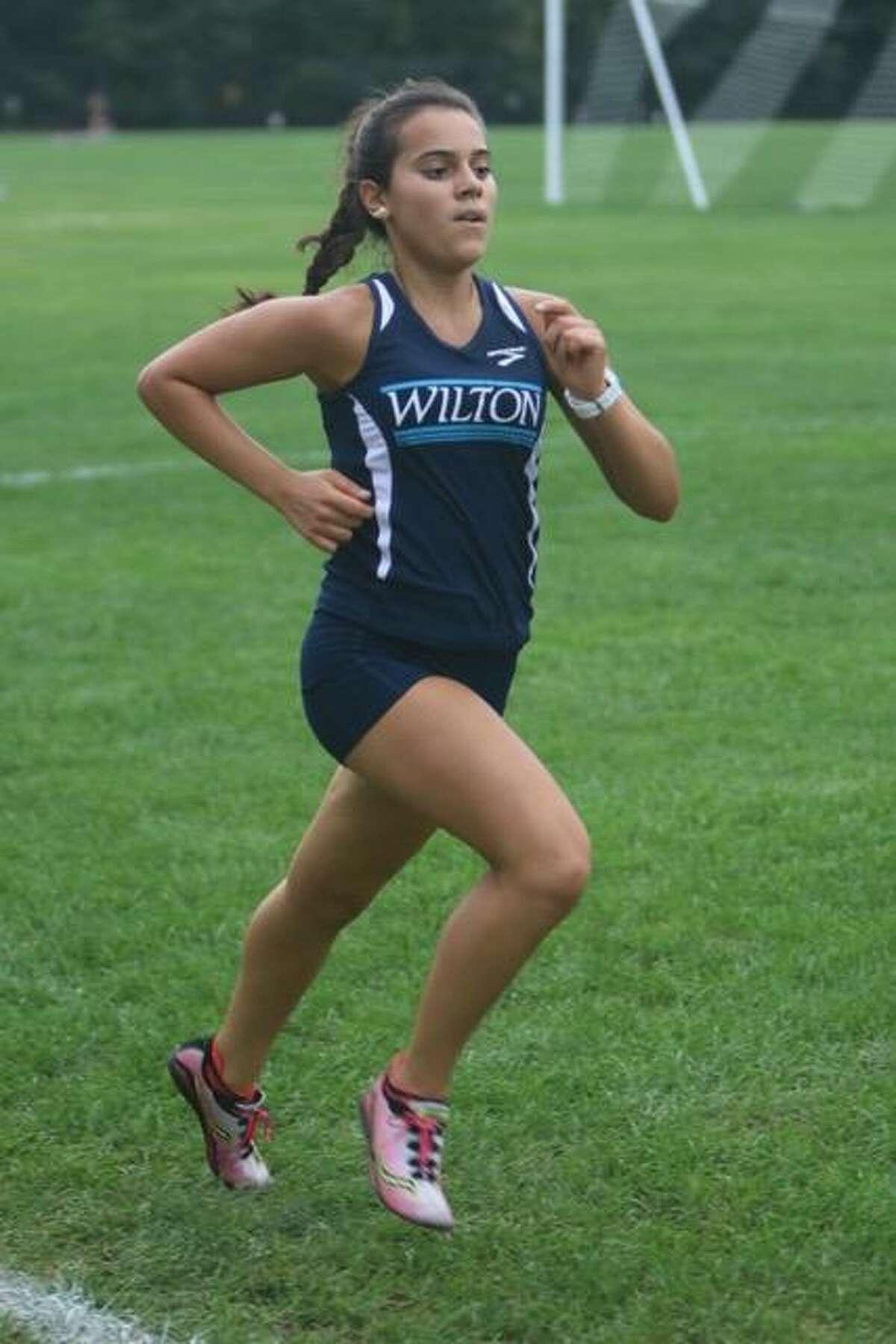 Paula Perez Pelaez runs a cross-country race for Wilton High School.